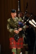 The piper marches in